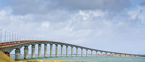 Traffic crossing causeway bridge connecting the island of Ile de Re with La Rochelle on the mainland in France