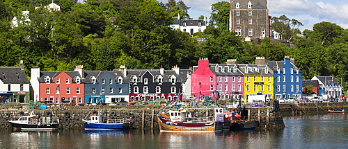 Multi-coloured buildings on the waterfront at Tobermory the capital of the Isle of Mull, Inner Hebrides, Scotland, United Kingdom, Europe
