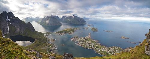 Panorama of the blue lake and sea framed by rocky peaks, Reinebringen, Moskenesoya, Lofoten Islands, Norway, Scandinavia, Europe
