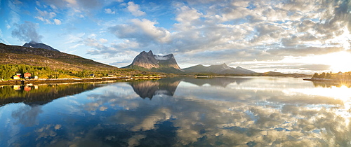 Panorama of pink clouds reflected in the clear blue sea at midnight sun, Anepollen Fjord, Nordland, Norway, Scandinavia, Europe
