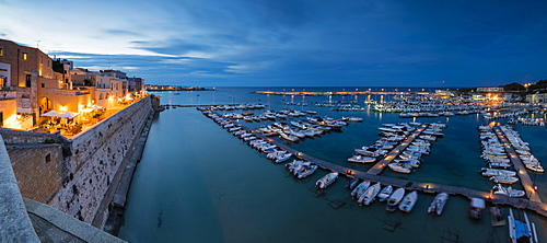Dusk lights the harbor and the medieval old town of Otranto, Province of Lecce, Apulia, Italy, Europe