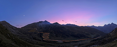 Panoramic of lights of car traces at sunset, Spluga Pass, Chiavenna Valley, Switzerland, Europe