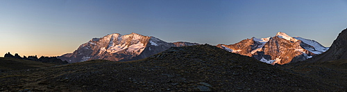 Panorama of Levanne mountains and Aiguille Rousse at sunrise, Gran Paradiso National Park, Alpi Graie (Graian Alps), Italy, Europe