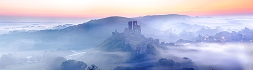 Corfe Castle in the mist, Corfe, Dorset, England, United Kingdom, Europe
