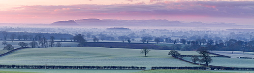 Panoramic view of Beeston Castle and the Peckforton Hills on a frosty winter morning over the Cheshire plain, Cheshire, England, United Kingdom, Europe