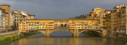 A panorama of the Ponte Vecchio bridge spanning the Arno River in Florence, UNESCO World Heritage Site, Tuscany, Italy, Europe