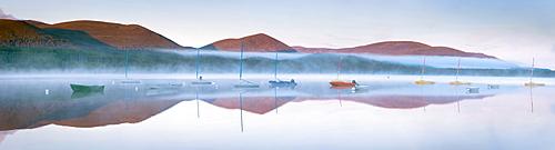 Daybreak in mid-summer over Loch Morlich, Glenmore, Cairngorms National Park, Scotland, United Kingdom, Europe