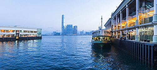 Star Ferry leaving Hong Kong Island, towards Kowloon at night, Hong Kong, China, Asia