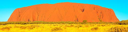 Banner panorama of majestic Uluru (Ayers Rock), the huge sandstone monolith in Uluru-Kata Tjuta National Park, icon of Australian outback or Red Centre, UNESCO World Heritage Site, Northern Territory, Australia, Pacific