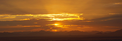 Panoramic view of sunset over mountains in the Namib Rand private reserve, Namib Desert, Namibia, Africa