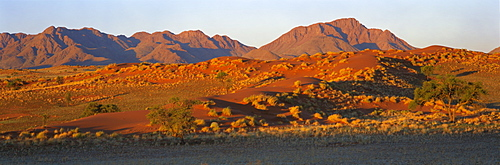 Panoramic view of mountains and dune glowing in last light before sunset, Namib Rand, Namib Naukluft Park, Namibia, Africa