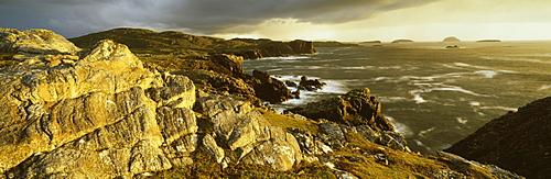 Stormy evening light on coastline near Carloway, Isle of Lewis, Outer Hebrides, Scotland, United Kingdom, Europe