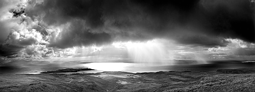 Panoramic view from An Sgurr on the Isle of Eigg, looking towards a storm over the sea between Eigg and the mainland, Highland, Scotland, United Kingdom, Europe