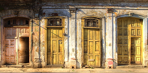 Facades of dilapidated colonial buildings bathed in evening light, Havana, Cuba, West Indies, Central America