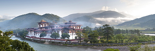 Misty dawn view of the Punakha Dzong located at the junction of the Mo Chhu (Mother River) and Pho Chhu (Father River) in the Punakha Valley, Bhutan, Himalayas, Asia