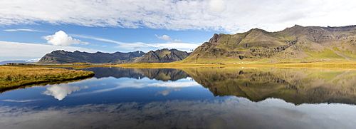 Panoramic view of mountains and blue sky reflecting in lake, near Vik, South Iceland, Polar Regions