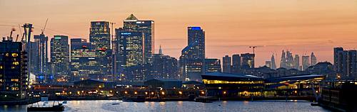 Canary Wharf and City Square Mile panorama from Royal Victoria dock, Docklands, London, England, United Kingdom, Europe