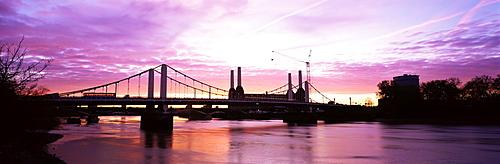 Dawn over Battersea Power Station and Chelsea Bridge, London, England, United Kingdom, Europe
