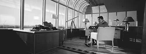 Woman in modern Office/Apartment, London