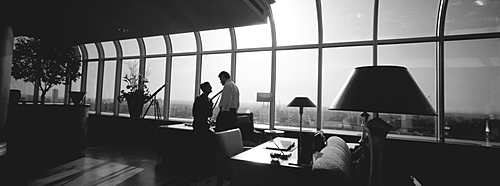 Man and Woman in modern Office/Apartment, London