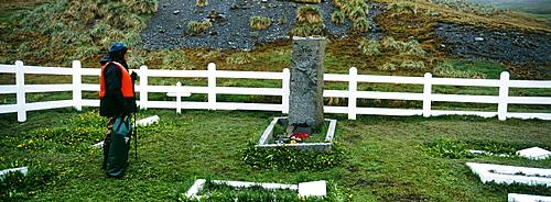 Tourist at Shackleton's Grave, Grytviken, South Georgia, South America
