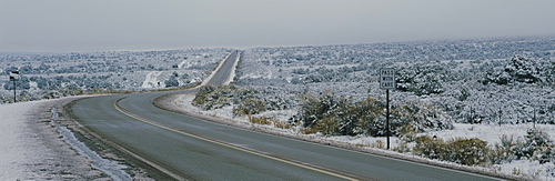 Two lane highway on a landscape, Taos, New Mexico, USA