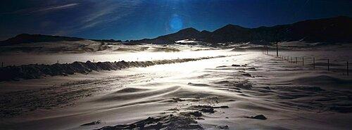 Road passing through a snow covered landscape, Cascade, Montana, USA