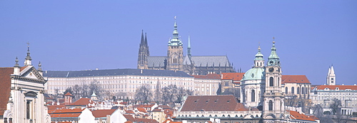 Low angle view of a church and a castle, Hradcany Castle, St. Nicholas Church, Prague, Czech Republic