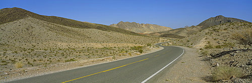 Empty road passing through a landscape, Nevada, USA