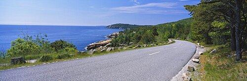 Empty road along an ocean, Acadia National Park, Maine, USA