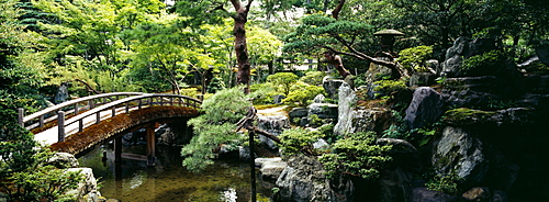 Footbridge across a pond, Kyoto Imperial Palace Gardens, Kyoto Prefecture, Japan