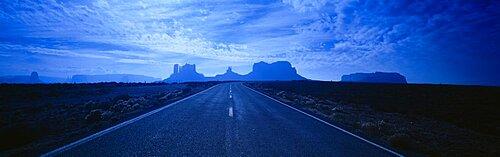 Empty Road Leading Towards Rock Formations, Monument Valley Tribal Park, Arizona, USA