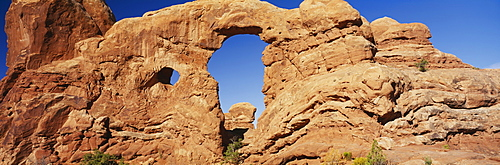 Low angle view of rock formations, Turret Arch, Arches National Park, Utah, USA