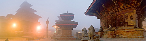 Misty winter dawn and temples in Durbar Square, including Degu Talle, Yoganarendra Malla on stone pillar, Jagan Naryan Mandir, UNESCO World Heritage Site, Patan, Kathmandu Valley, Nepal, Asia
