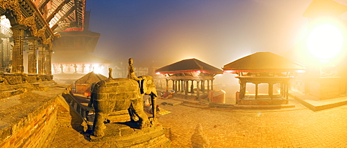 Foggy dawn in Durbar Square, containing elephant statues at the foot of the Bishwanath Mandir, and steps to drinking water tap of Manga Hiti, UNESCO World Heritage Site, Patan, Kathmandu, Nepall, Asia