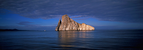 Two spectacular volcanic plugs form Kicker rock, a favorite scuba diving site located off San Cristobal Island, Galapagos Islands, Ecuador