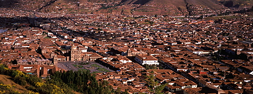 Ancient capital of the Incas skyline of the city showing colonial center with the Plaza de Armas, Cathedral and La Compania Church, Cuzco, Highlands, Peru