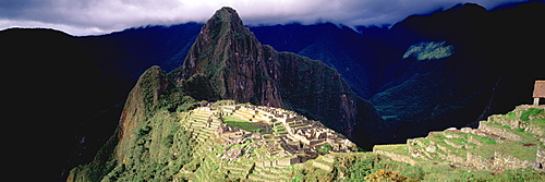 Machu Picchu view of the ancient city with Huayna Picchu peak above on the Rio Urubamba in the Vilcabamba Mountains,, Highlands, Peru