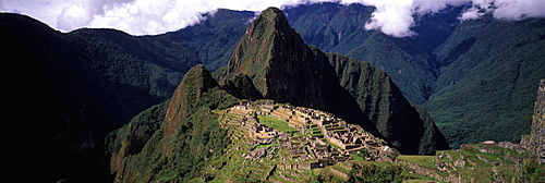 Machu Picchu view of the ancient city with Huayna Picchu peak above on the Rio Urubamba in the Vilcabamba Mountains, Highlands, Peru