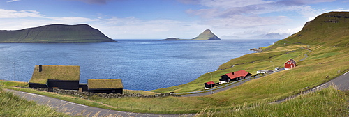 Panoramic view of Velbastadur village, turf-roofed houses, Hestfjordur, Hestur on the left, and Koltur islands in the distance, Streymoy, Faroe Islands (Faroes), Denmark, Europe