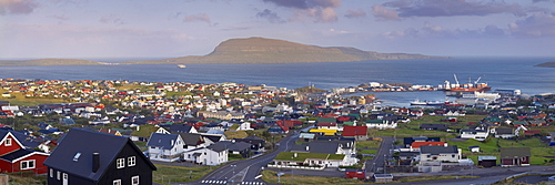 Panoramic view of Torshavn and harbour (Nolsoy in the distance), capital of the Faroe Islands (Faroes), Denmark, Europe
