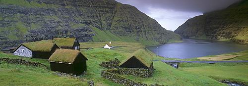 Traditional turf roofed farm buildings and church, Saksun, Streymoy Island, Faroe Islands (Faroes), Denmark, Europe