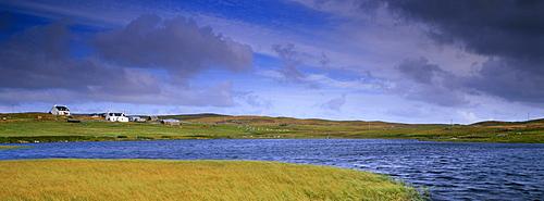 Small loch and houses near Greenland (Burraland), near Walls, West Mainland, Shetland Islands, Scotland, United Kingdom, Europe