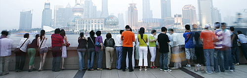 People on the Bund looking over to the Oriental Pearl Tower and the Pudong District, Shanghai, China, Asia