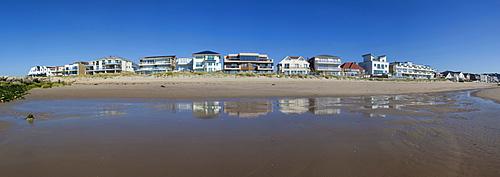 Row of houses overlooking the sea, Sandbanks, Poole, Dorset, England, United Kingdom, Europe