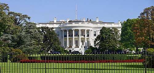 USA, Washington DC, South Portico of the White House with the Stars and Stripes flag flying at half mast.