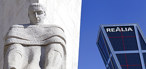 Spain, Madrid, Puerta de Europa with the monument to Calvo Sotelo in the foreground at Plaza de Castilla.