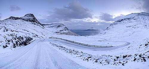 Snow covered mountain road in winter on the Island of Streymoy, Faroe Islands, Denmark, Europe