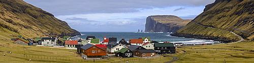 Panorama of the pretty coastal village of Tjornuvik on the island of Streymoy, Faroe Islands, Denmark, Europe