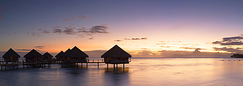 Overwater bungalows at Le Meridien Tahiti Hotel at sunset, Papeete, Tahiti, French Polynesia, South Pacific, Pacific